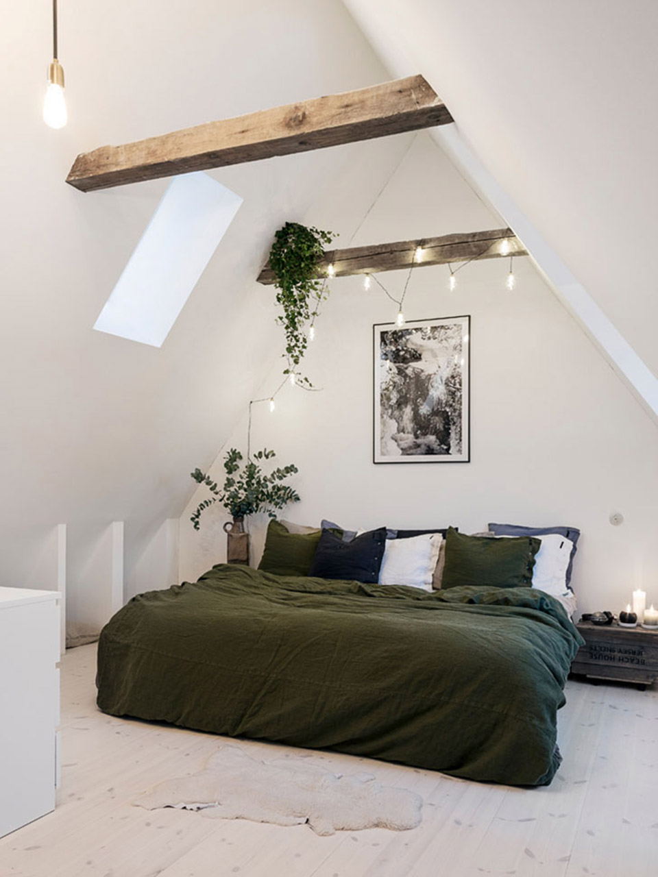 attic bedroom with high ceilings and wood beams