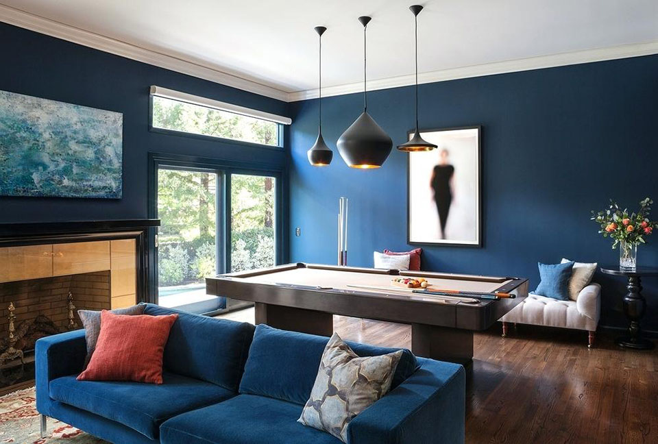 Warm blue living room with pool table