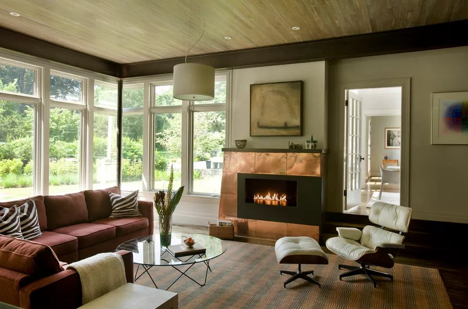 warm wine color couch copper fireplace