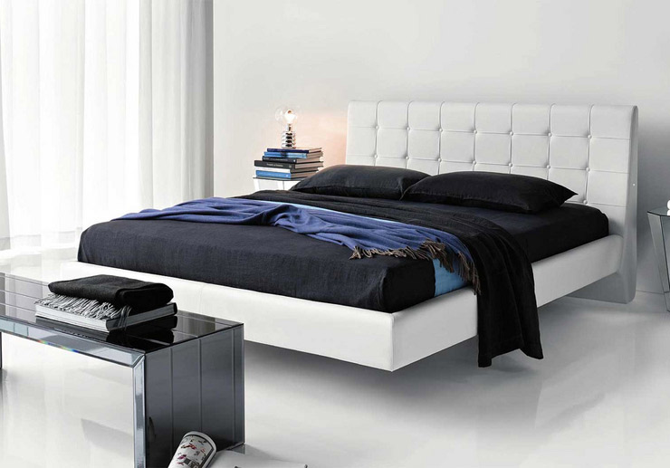 modern designer leather bed in a bright bedroom
