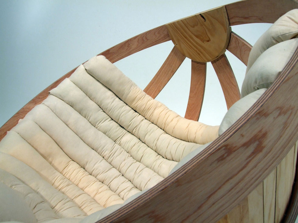 wooden rocking chair with white cushions
