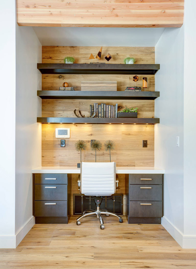 small office with hardwood wall