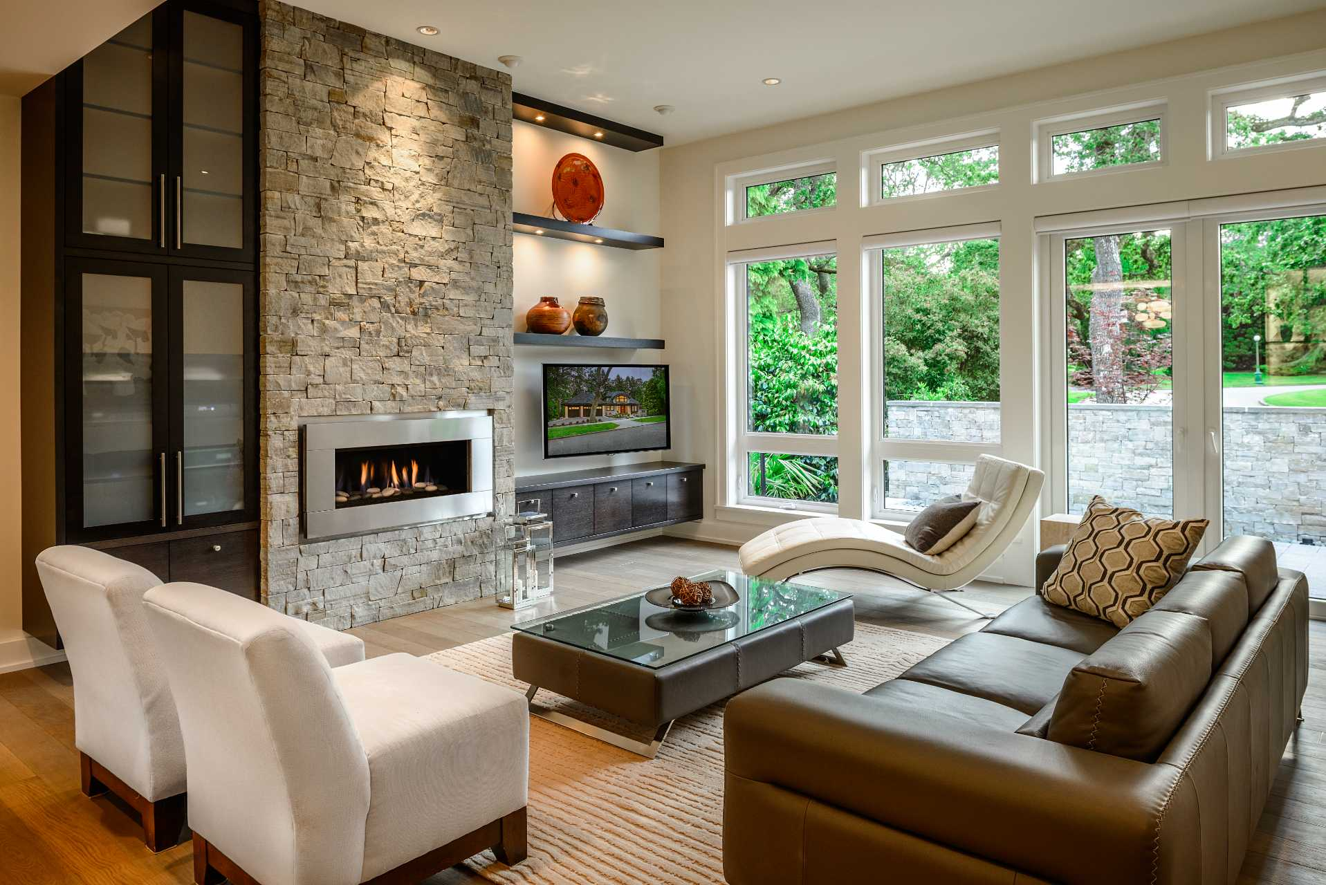 living room stone wall gas fireplace