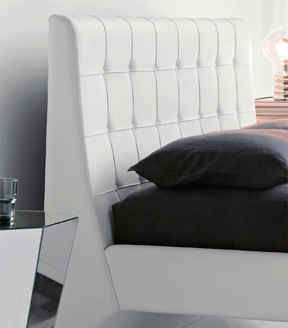 white leather upholstered headboard